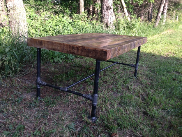 rustic table with poly and black pipe